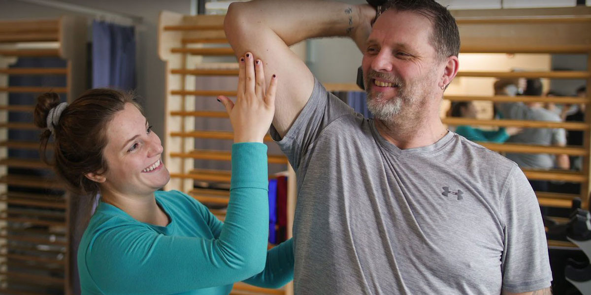 Physiotherapist Working With the Client | Richmond Blundell Physiotherapy and Sports Injury Clinic